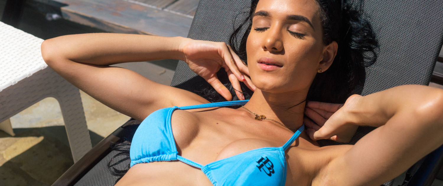 Tai working on her tan at Blue Paradise DR